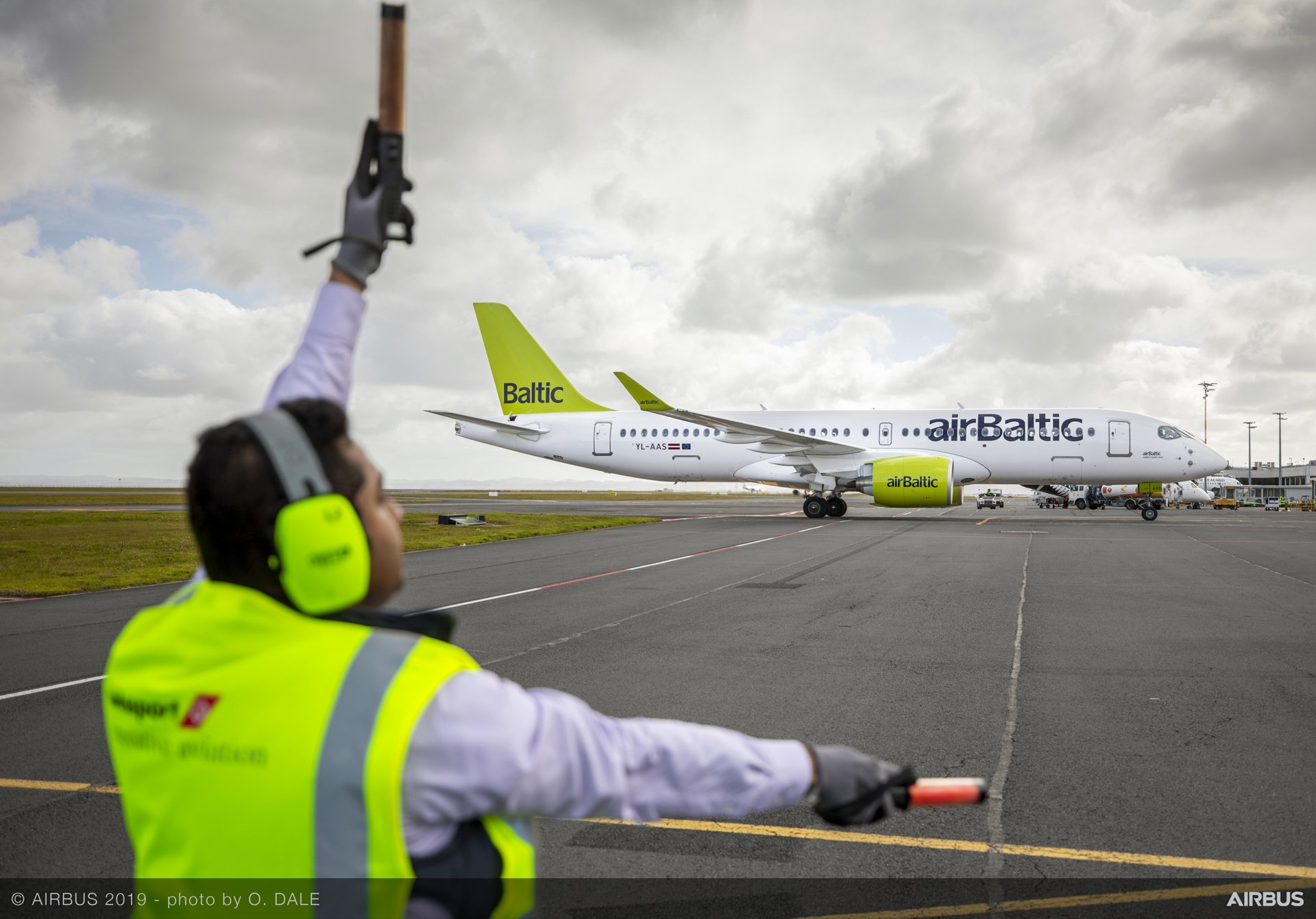 The airBaltic A220-300 used for Airbus' A220 demonstration tour of the Asia-Pacific region taxis during its visit to Auckland, New Zealand