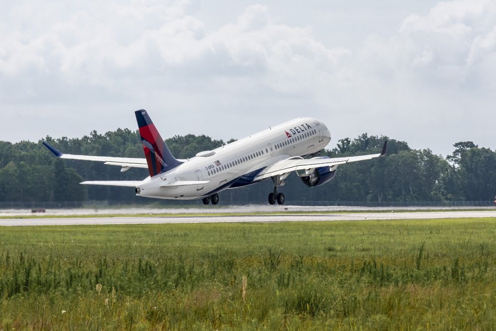The first Airbus A220 assembled in the U.S., received by Delta Air Lines, is shown during take-off.