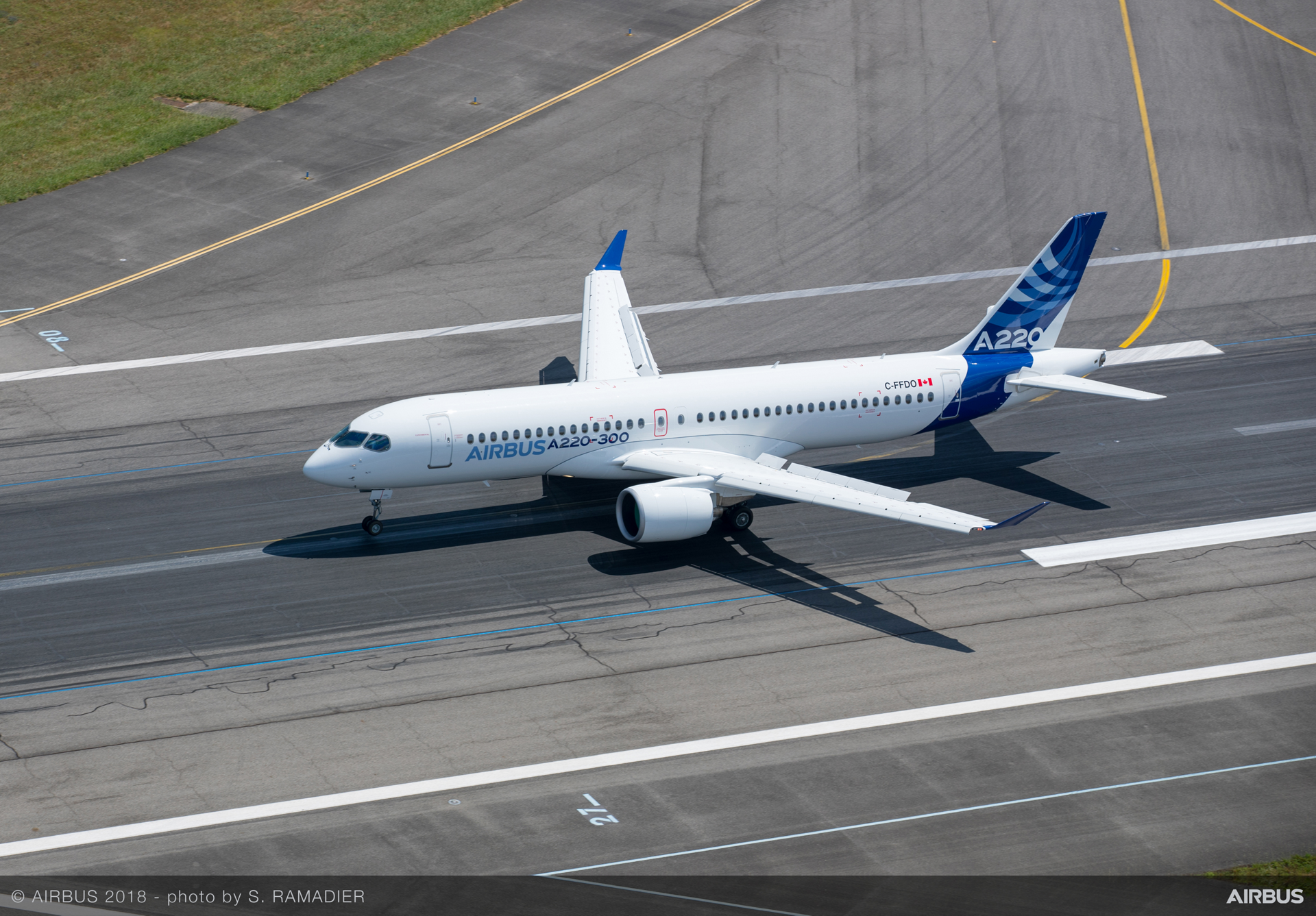 The A220-300 completes its runway rollout at France's Toulouse-Blagnac Airport for the reveal of the single-aisle A220 Family's new identity at Airbus' headquarters operation in France