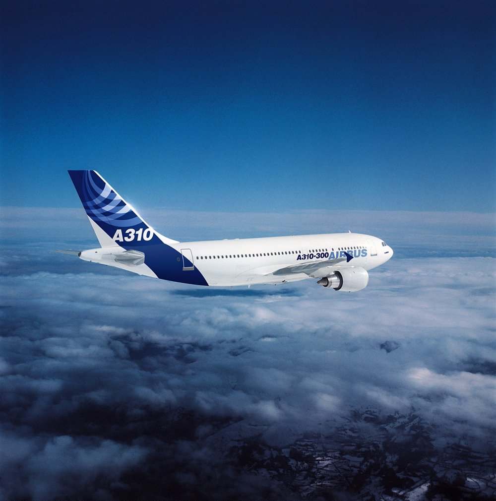 Side view of an Airbus A310 in flight