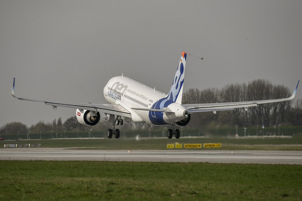 A rear view of Airbus' first A319neo as the aircraft takes for its maiden flight from Germany's Hamburg-Finkenwerder Airport