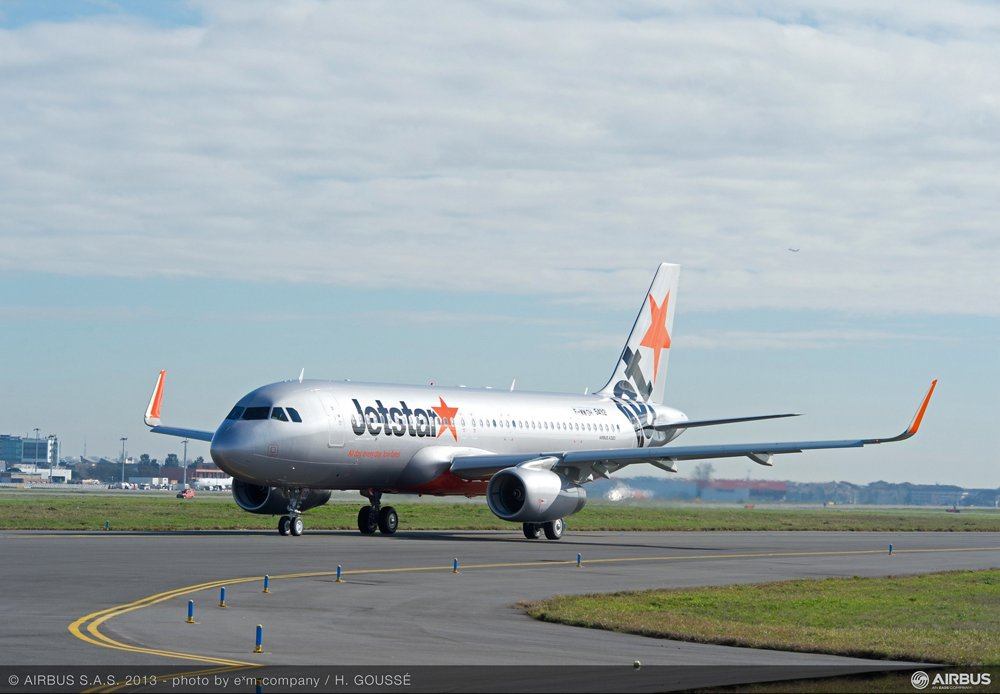 An A320 delivered to Jetstar Pacific taxis at an airport.