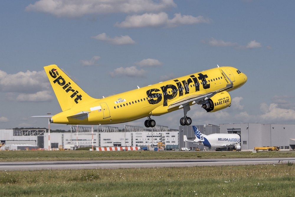 An A320neo commercial aircraft in the livery of U.S.-based Spirit Airlines is shown during take-off.