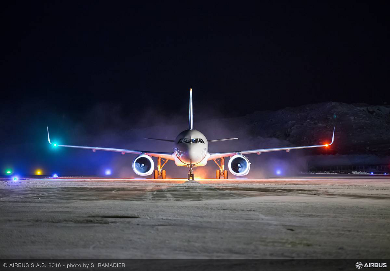 Seen head-on, this Airbus A320neo shows its port (left side) and starboard (right side) red and green position lights