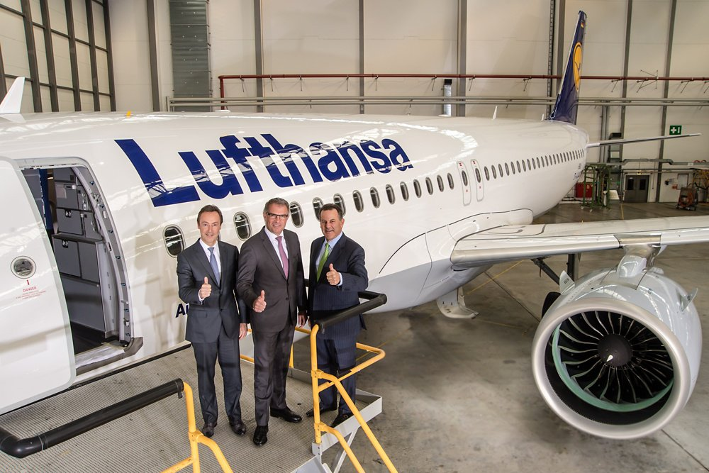 Executives from Airbus, Deutsche Lufthansa AG and United Technologies celebrate the first A320neo delivery to Lufthansa