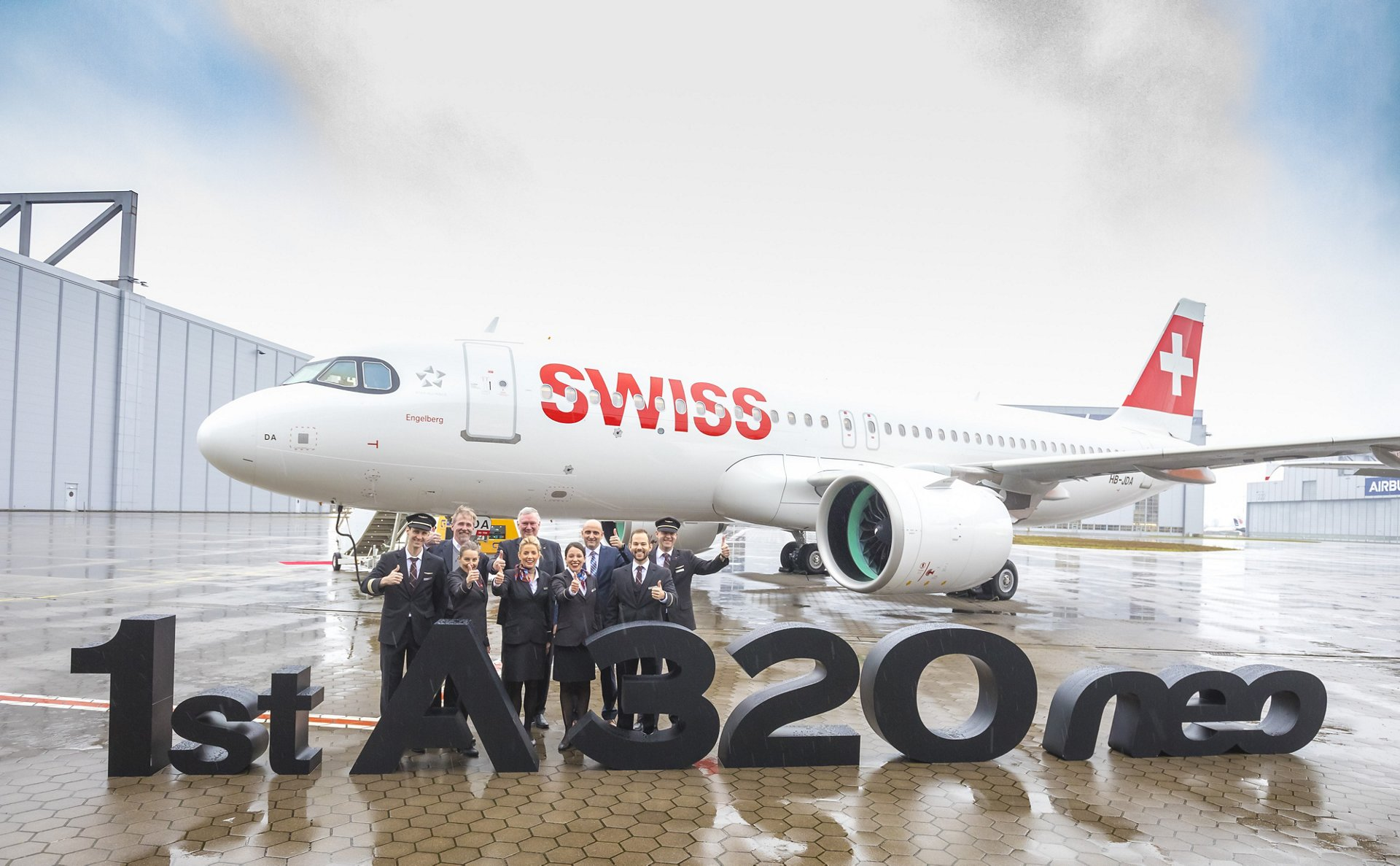 From left to right at the delivery ceremony in Hamburg, Germany: Bruce Hall, Director Pratt & Whitney Airbus Operations; Peter Wojahn, SWISS Chief Technical Officer; and Carlos Alcántara, Head of Acceptance & Delivery A320 Family Final Assembly Line Hamburg, along with SWISS crew members