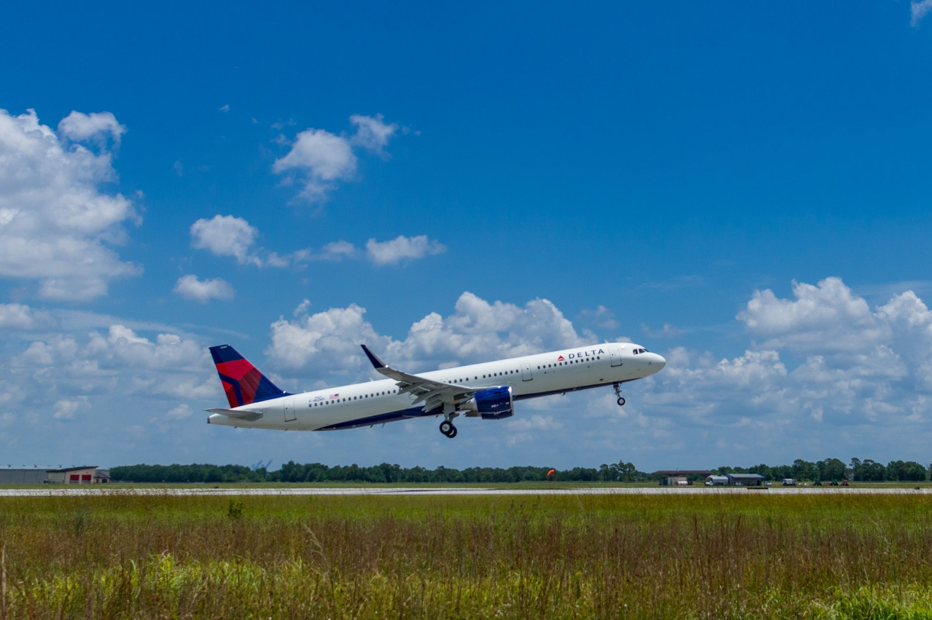 Airbus has delivered Delta Air Lines' 50th A320 Family jetliner produced in the U.S. manufacturing facility at Mobile, Alabama; this aircraft – an A321 – is shown during a pre-delivery test flight