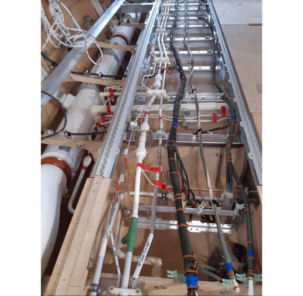 One of the early wooden mockups was used to verify the accessibility and installation of the electrical and mechanical systems installation, including the air conditioning piping, hydraulic piping, bleed air piping and fuel lines.