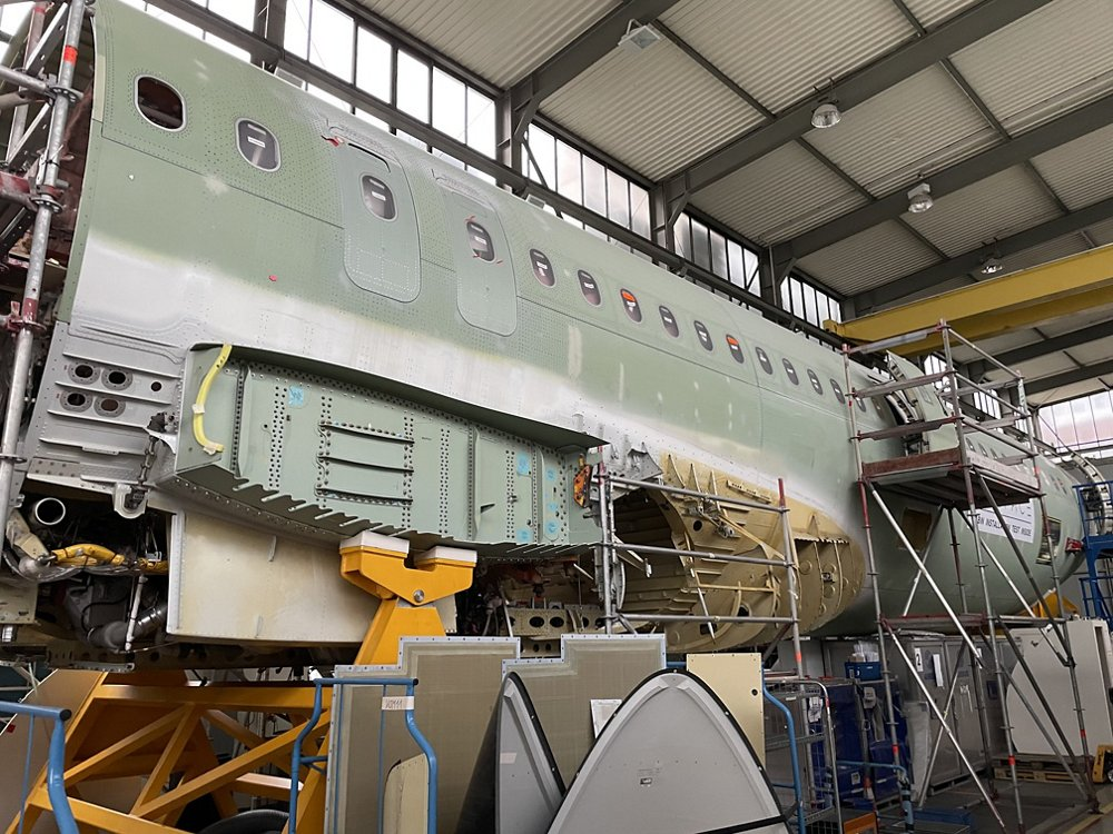 External view of the PISA demonstrator Centre & Aft Fuselage (CAF) in Hamburg, The belly fairing panels are temporarily removed to allow installation of the -XLR specific structure and systems.