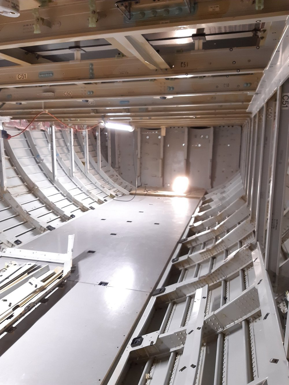 Internal view of the PISA demonstrator's lower-deck aft section, in the area of the -XLR's dedicated Rear Centre Tank (RCT). Here structure 'dummies' and systems related to the RCT installation are being integrated.
