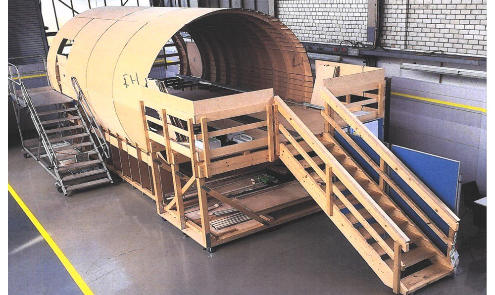 Wooden mockups were used early in the -XLR development phase. This one is in Hangar 10 in Hamburg, to verify the systems installation concepts in the aircraft's Rear-Centre Tank (RCT) area.