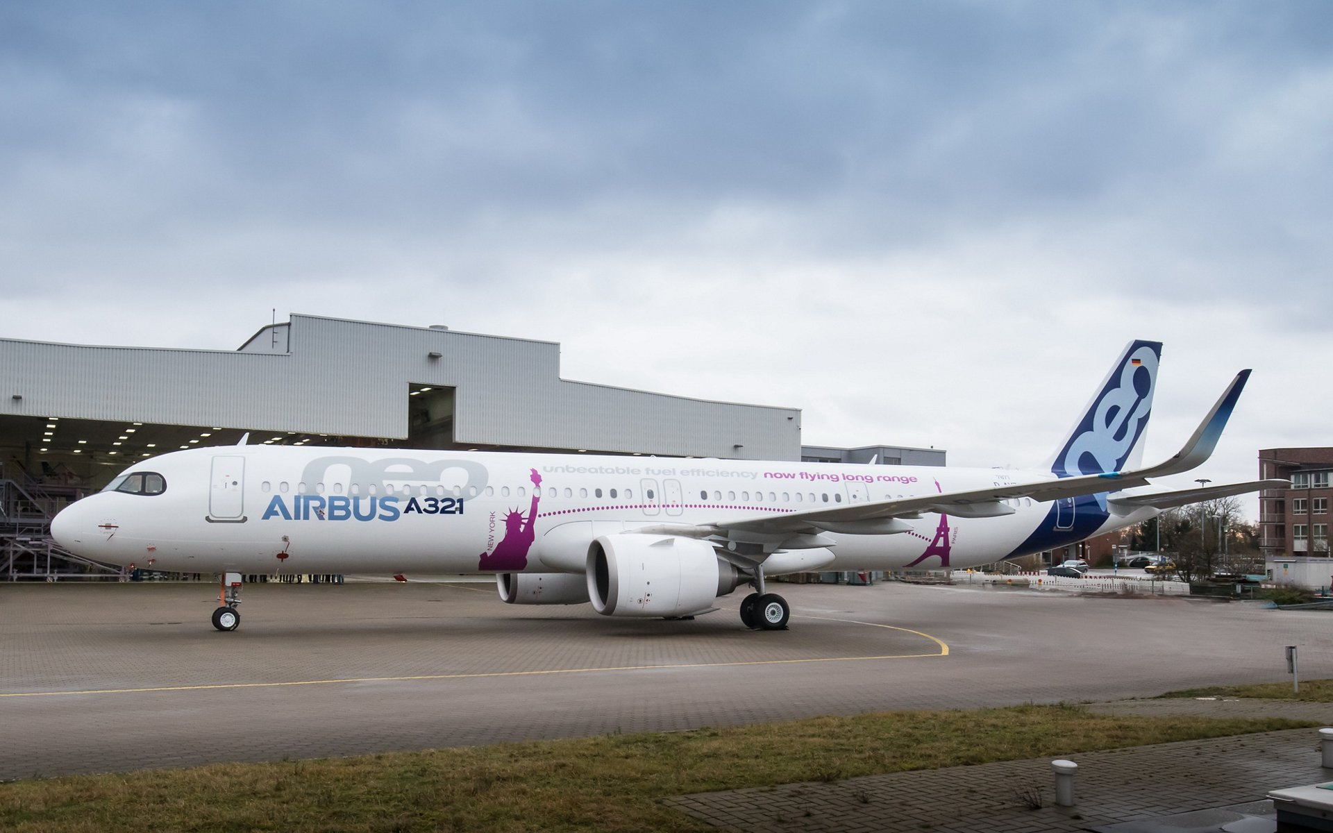 Airbus rolls out its first A321neo ACF (Airbus Cabin Flex) in Hamburg with the Eiffel Tower in Paris and the Statue of Liberty in New York illustrating its transatlantic flight capability on its livery