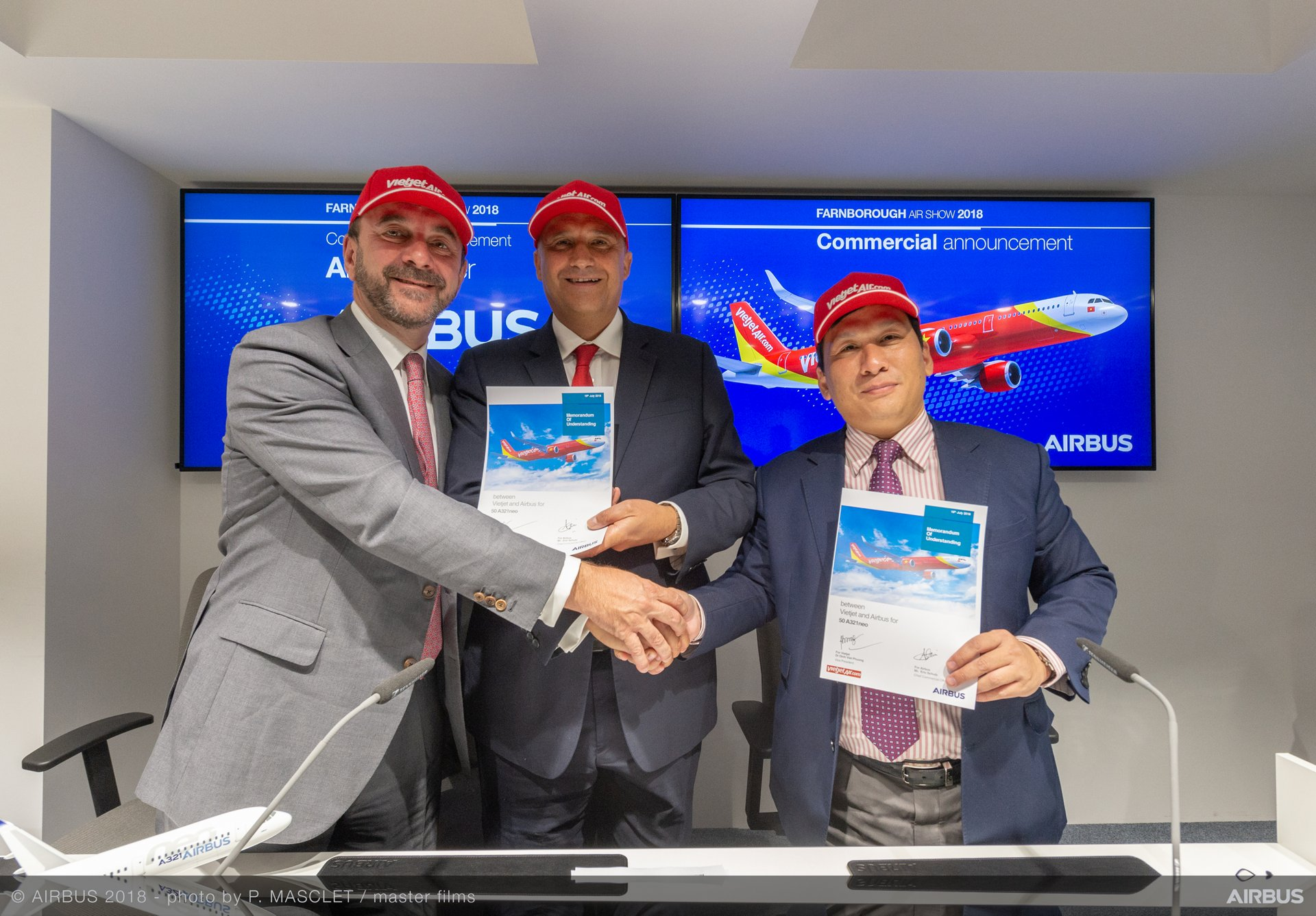 The signing of Vietjet's memorandum of understanding with Airbus for the purchase of 50 additional A321neo single-aisle aircraft is marked on Day 4 of the Farnborough Airshow by (from right to left): Vietjet Vice President Dinh Viet Phuong; Airbus Chief Commercial Officer Eric Schulz; and Jean Francois Laval, Airbus Executive Vice President, Asia