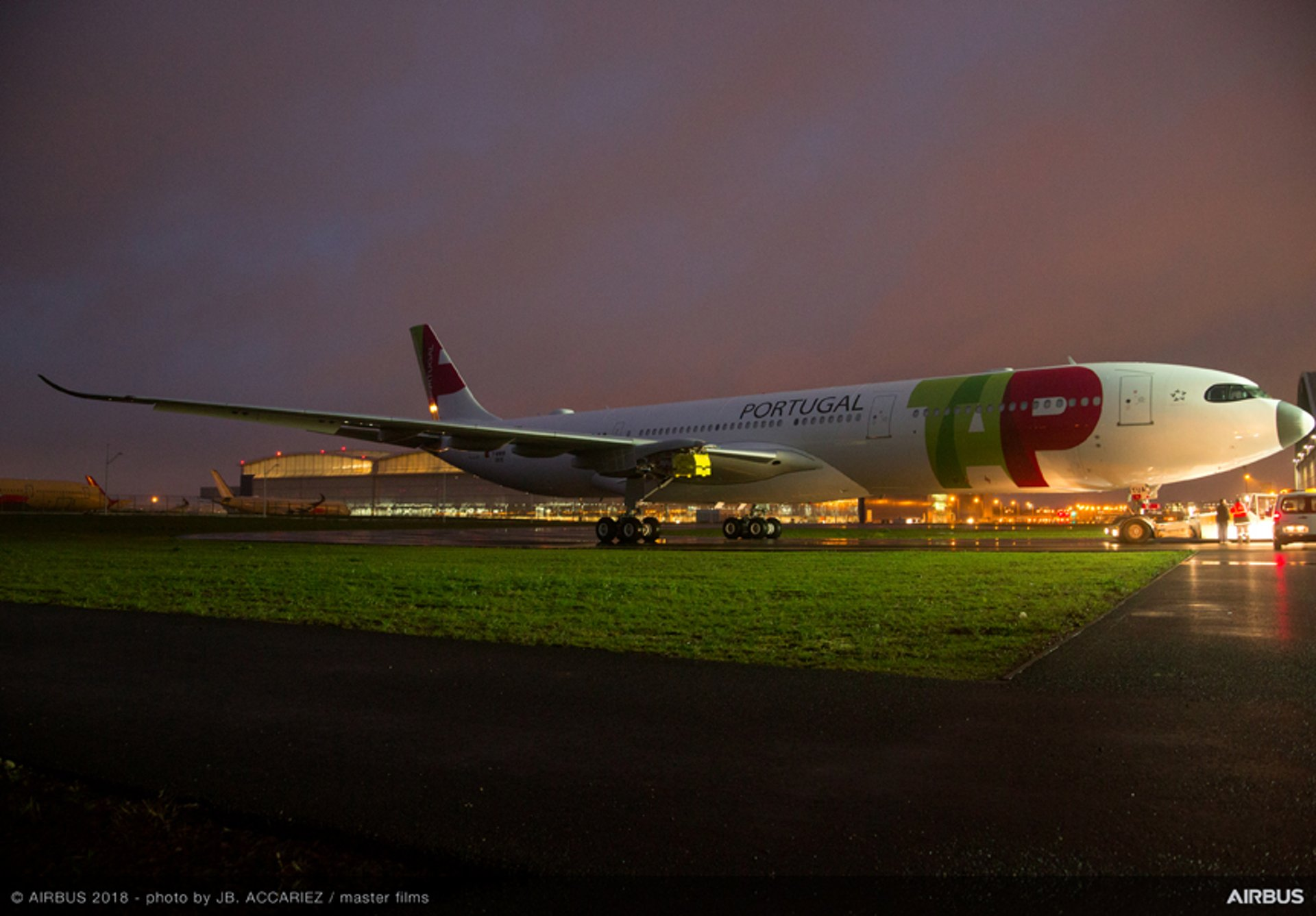 One of TAP Air Portugal's initial two A330neo jetliners rolls out of the paint shop in the red and green livery of this launch operator for Airbus' newest A330 variant