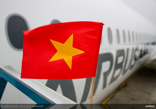 Hanoi's flag (Vietnam) in front of A350-1000 Airbus on ground