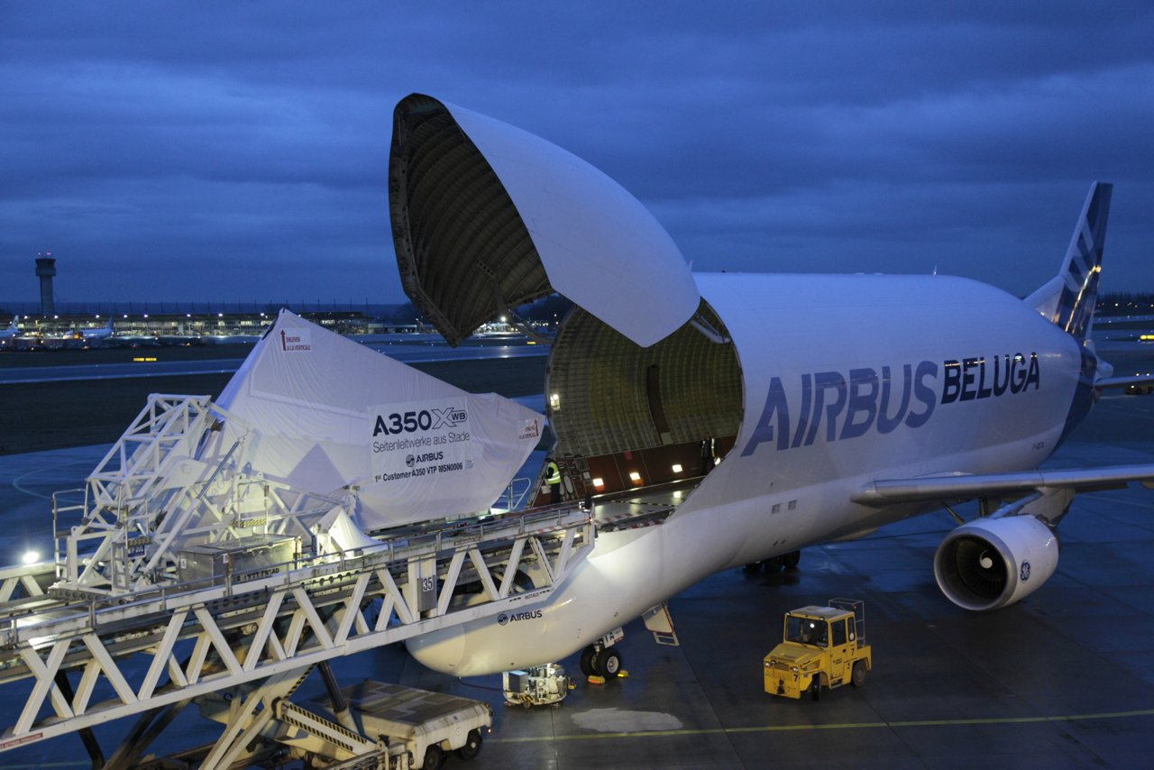 An Airbus A300-600ST Beluga oversize airlifter transports the vertical tail plane for Qatar Airways' first A350-900 jetliner from Stade, Germany to the A350 XWB final assembly line in Toulouse, France