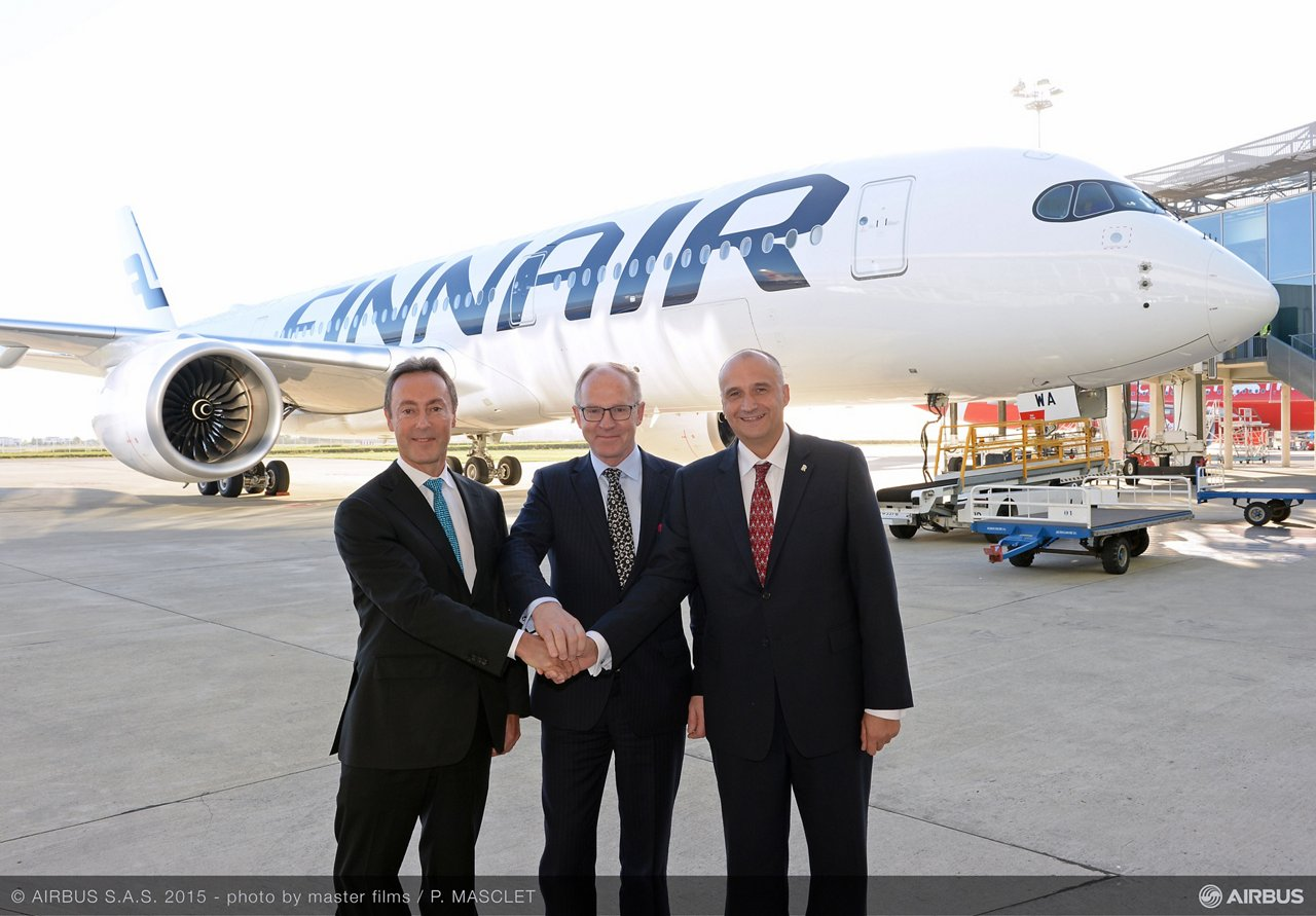 Marking the delivery of Finnair's first A350 XWB on 7 October 2015 are (from left-to-right): Airbus President and CEO Fabrice Brégier– Finnair CEO Pekka Vauramo– and Eric Schulz, President – Civil Large Engines, Rolls-Royce