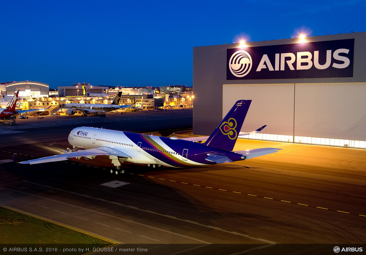 Bearing its distinctive airline livery, THAI's first A350 XWB emerges from the Airbus paint shop in Toulouse, France following the completion of painting