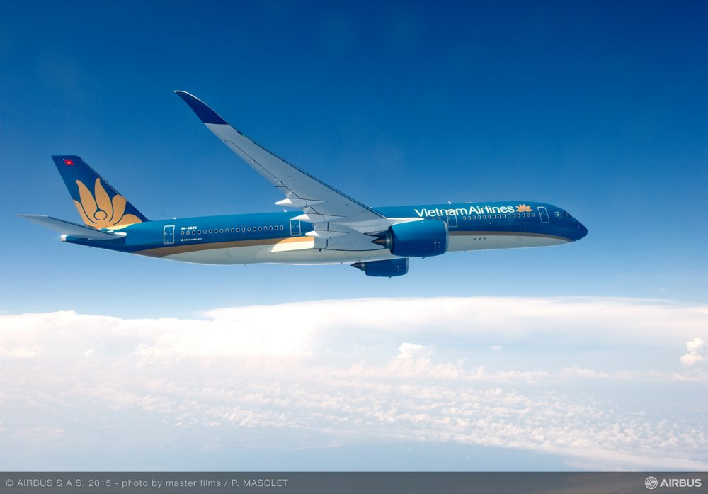Side view of an in-flight A350 XWB in the colours of Vietnam Airlines.