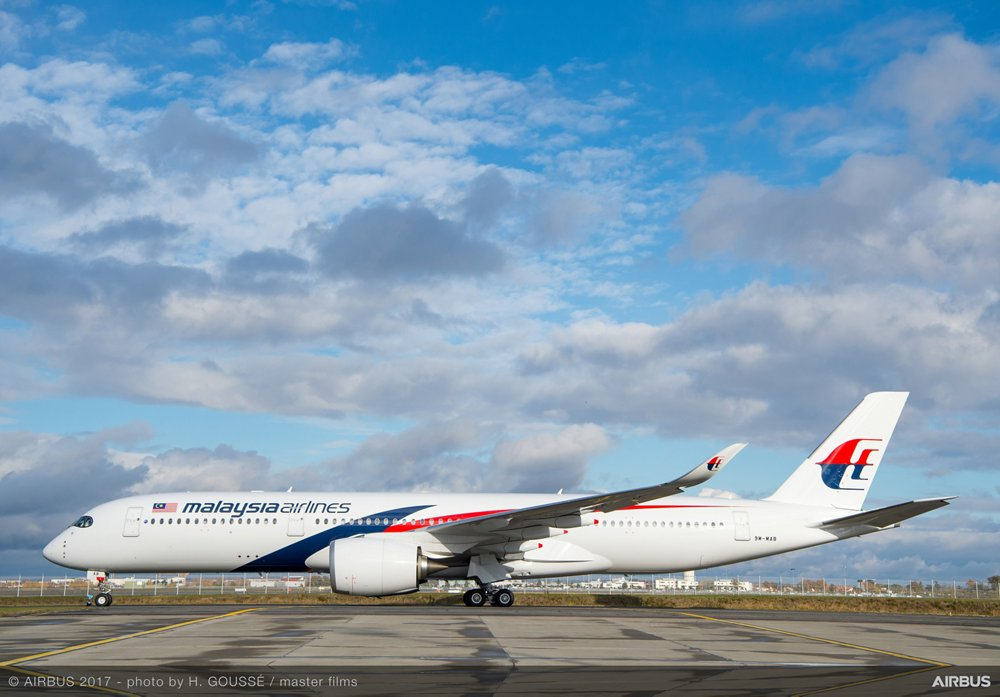 On-ground photo of an Airbus A350-900 aircraft in the livery of Malaysia Airlines.