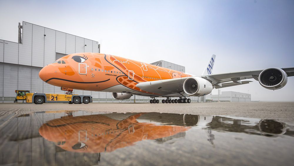 The orange design for All Nippon Airways' third A380, inspired by the Hawaiian sunset, was shown for the first time after the aircraft rolled out from Airbus' paint shop in Hamburg, Germany
