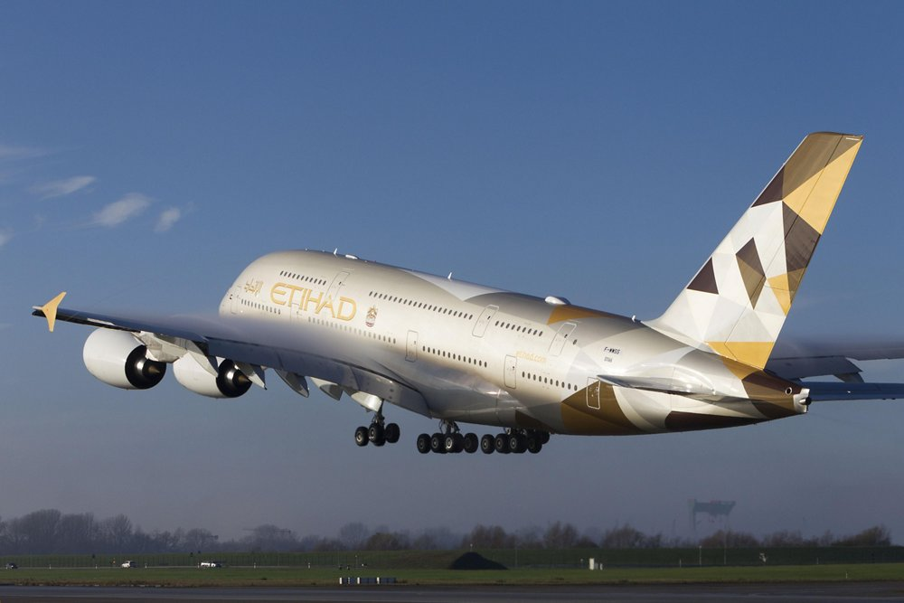 An A380 in Etihad Airways' colours; this carrier received the first of its Airbus double-deck jetliners in 2014.
