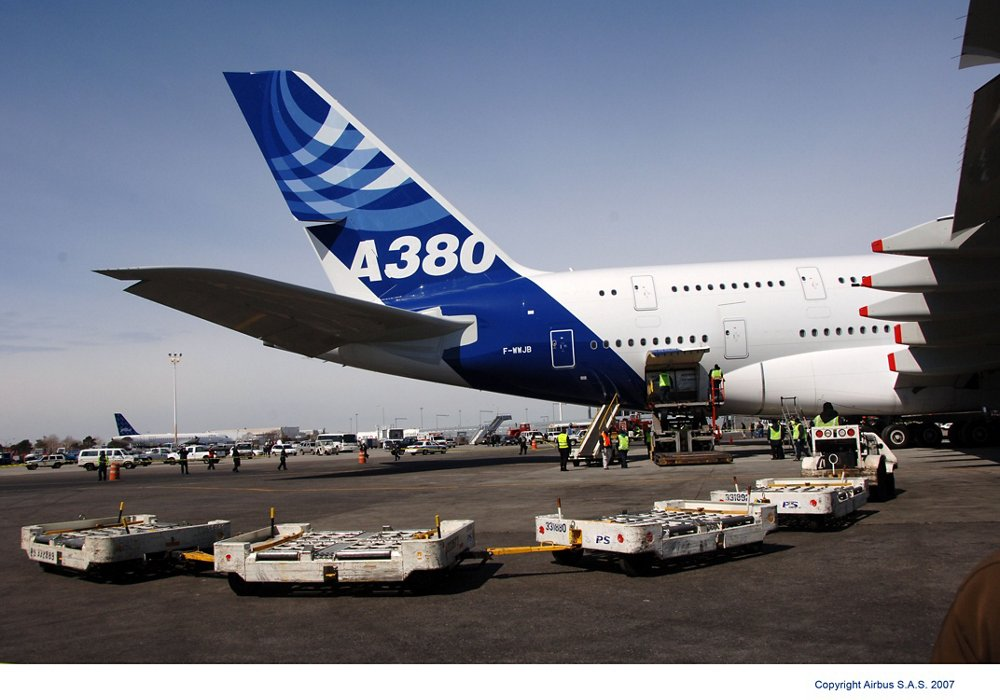 Cargo is unloaded from a parked Airbus A380