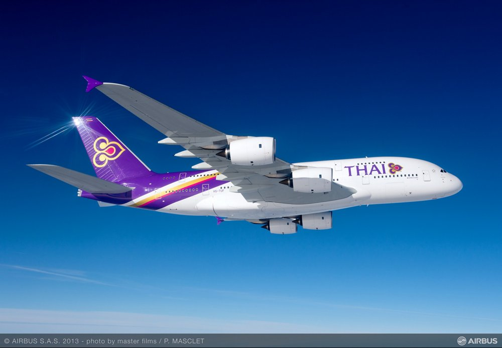 Side view of an in-flight Airbus A380 aircraft delivered to Thai Airways International.