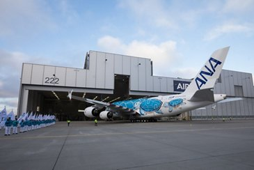 First A380 for ANA rolls out of Airbus paint shop