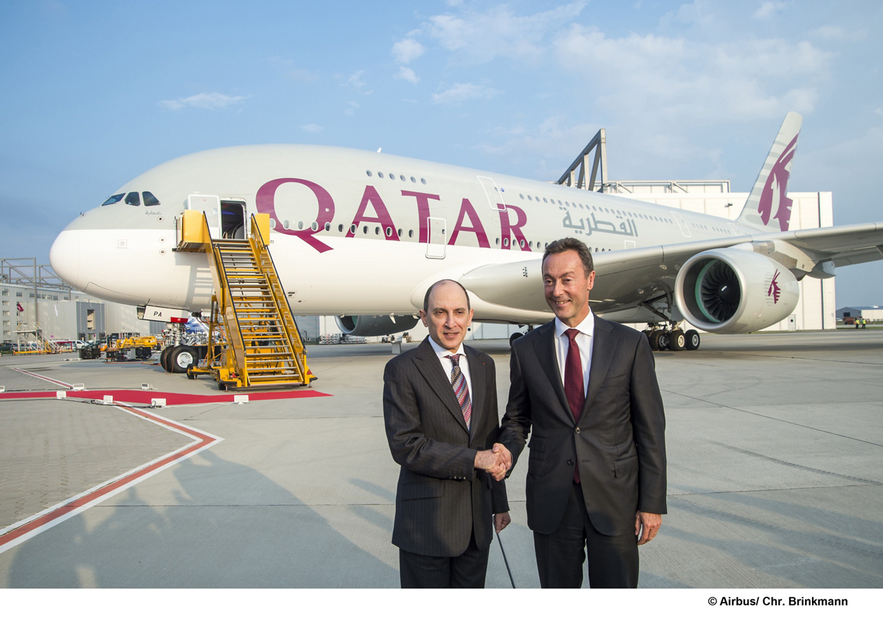Handing over Qatar Airways' new A380 flagship: Airbus President and CEO Fabrice Brégier (at right) marks the milestone delivery with His Excellency Akbar Al Baker, Qatar Airways Group Chief Executive -
