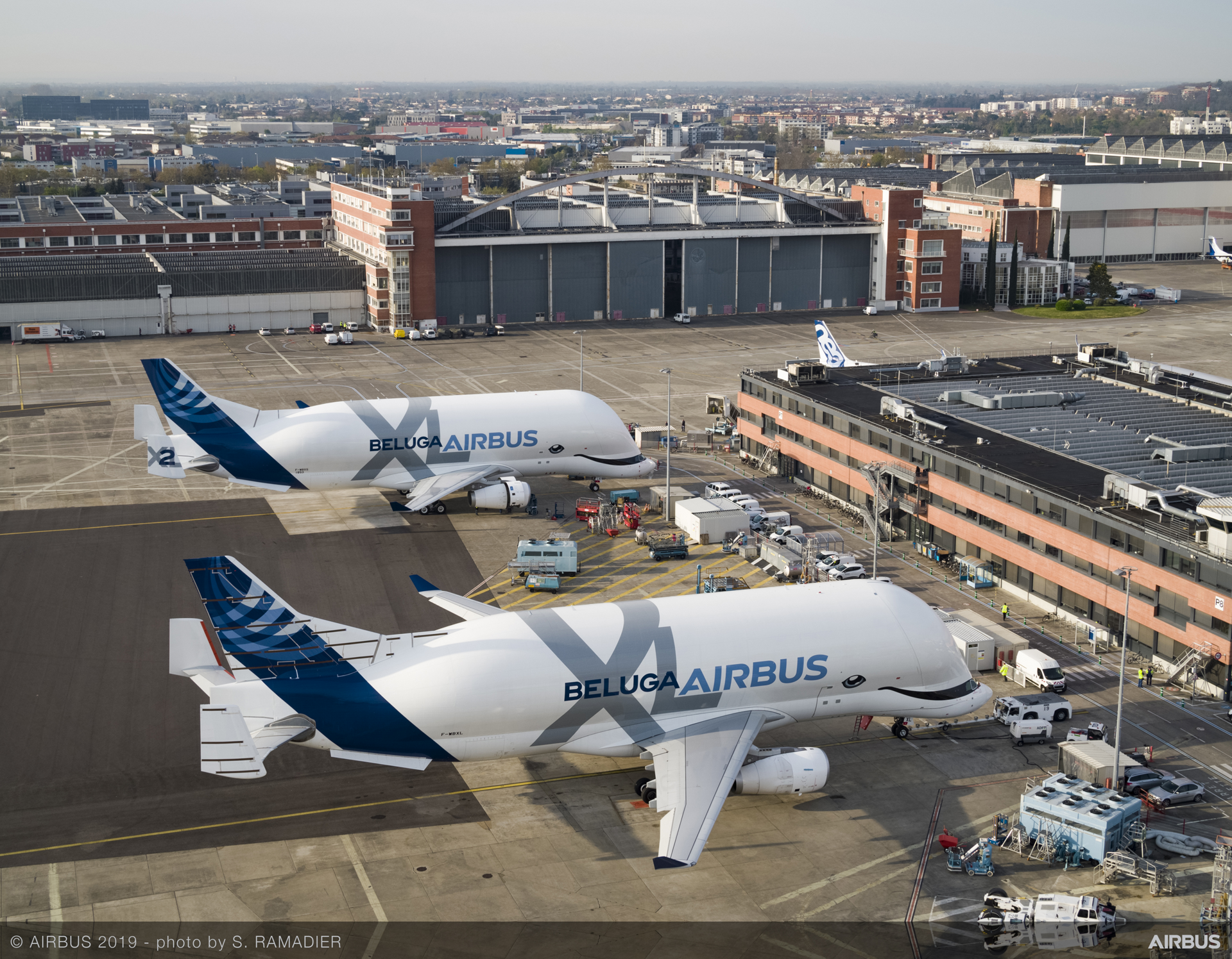 The first two BelugaXLs – highly-modified A330 jetliners tailored to carry large airframe components within the Airbus aircraft production network – meet up in Toulouse, France