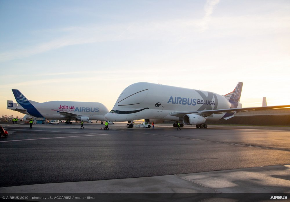 The two generations of Airbus airlifters are shown together: the BelugaXL and Beluga ST