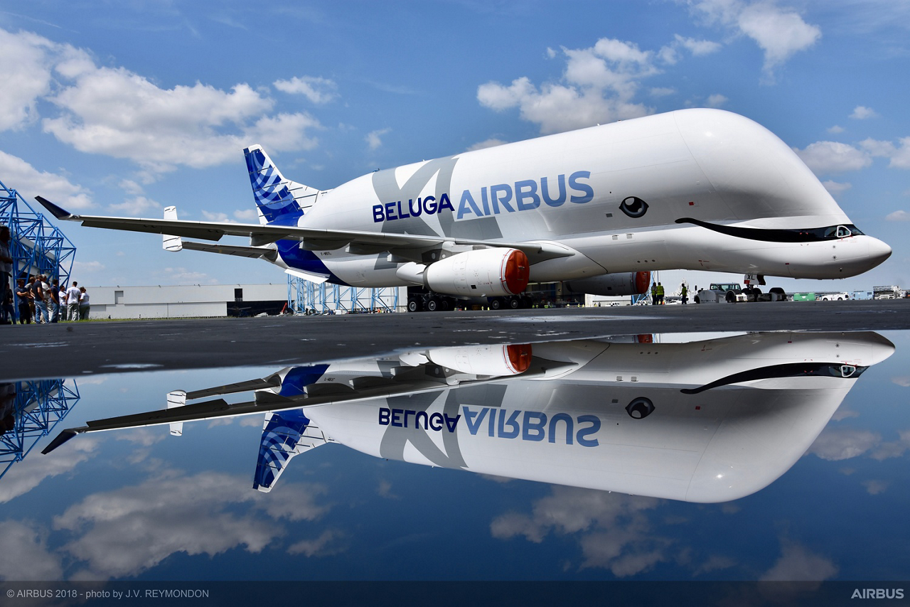 The first BelugaXL oversize cargo airlifter shows off its special beluga whale-inspired livery, which was selected by Airbus employees, after rolling out of the paint shop