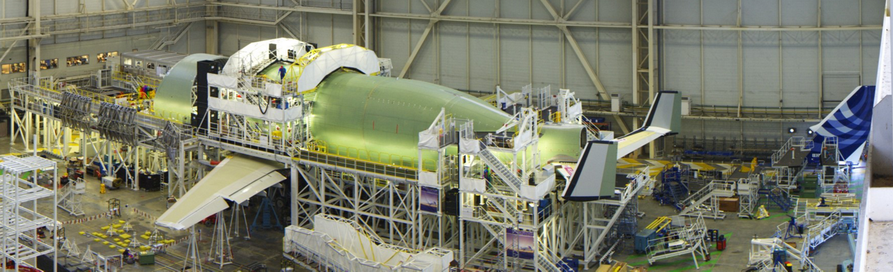 The first of five Airbus BelugaXL super transporters is well advanced in the build-up process, shown here being readied for its electrical power-up milestone.
