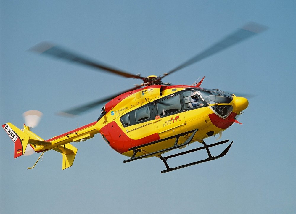 Side view of an in-flight BK117 C2 helicopter.