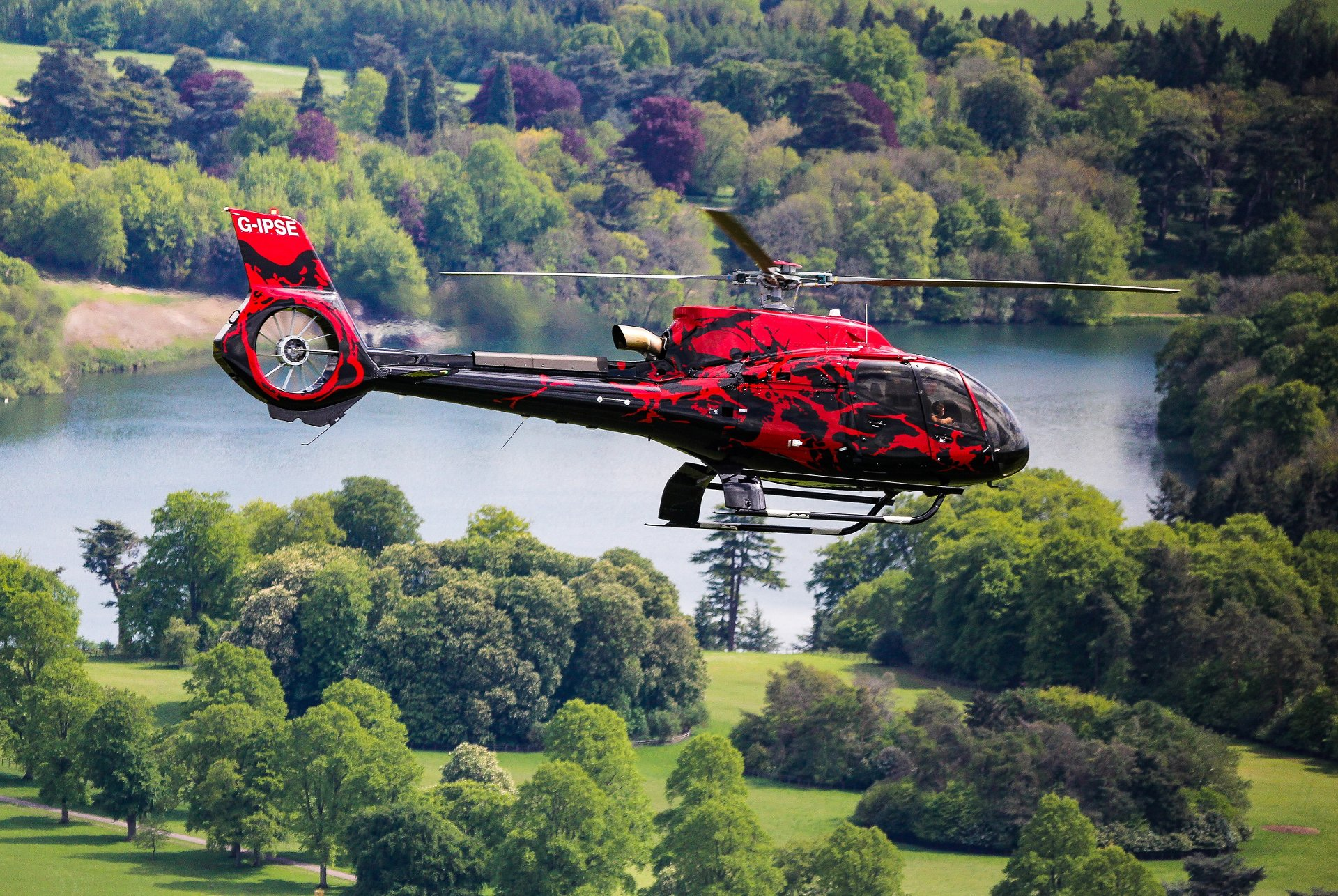 This strikingly painted Airbus ACH130 helicopter, captured here over the English countryside, is due to be delivered to mobile home park entrepreneur Alfie Best a few days after the 2019 EBACE exhibition.