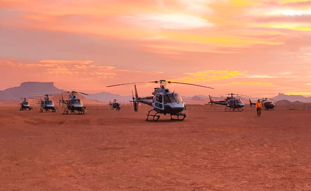 A group photo of the H125s and H130s operated by The Helicopter Company at the 2021 Dakar Rally.