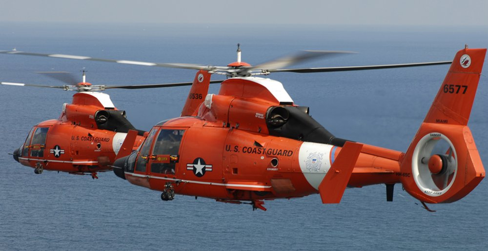Two Coast Guard HH-65 Dolphin helicopters from Air Station Miami in formation