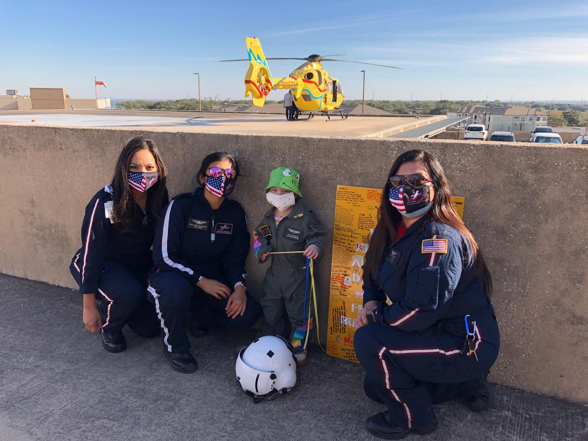 Crew members from Methodist AirCare welcomed their new honorary teammate Bodhi with a flight aboard the operator's EC135 helicopter, visible in the background