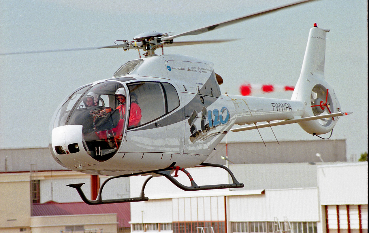 The EC120 Colibri is shown during its 1995 maiden flight, with a view of the two pilots inside the cockpit.
