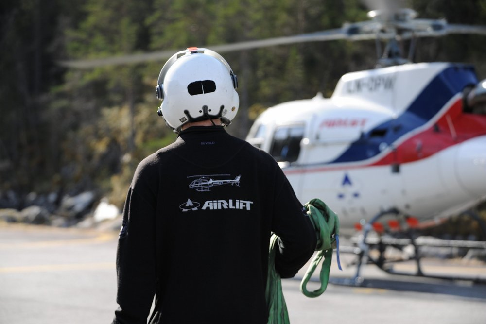 An airlift team member approaches an H125 helicopter