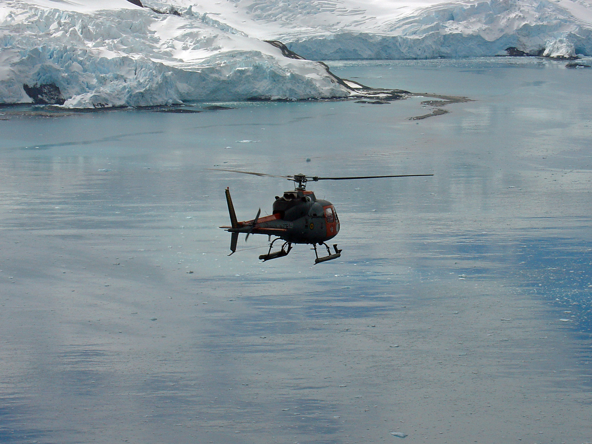 Image of H125 flying above Arctic sea