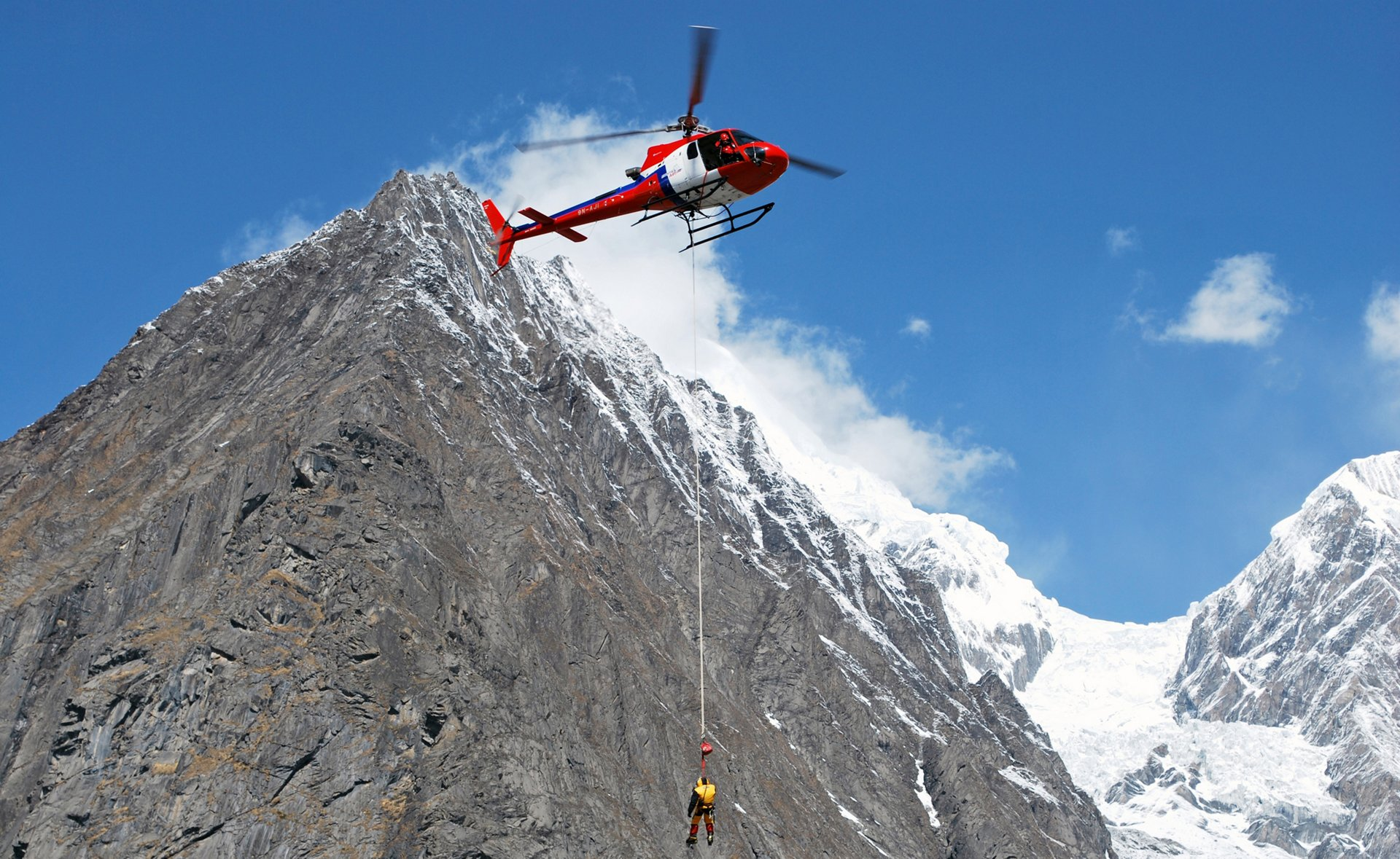 Pilots and helicopters carry out thousands of mountain rescues in the Himalayas annually. Pictured here, an H125 from Fishtail Air performs a rescue mission.
