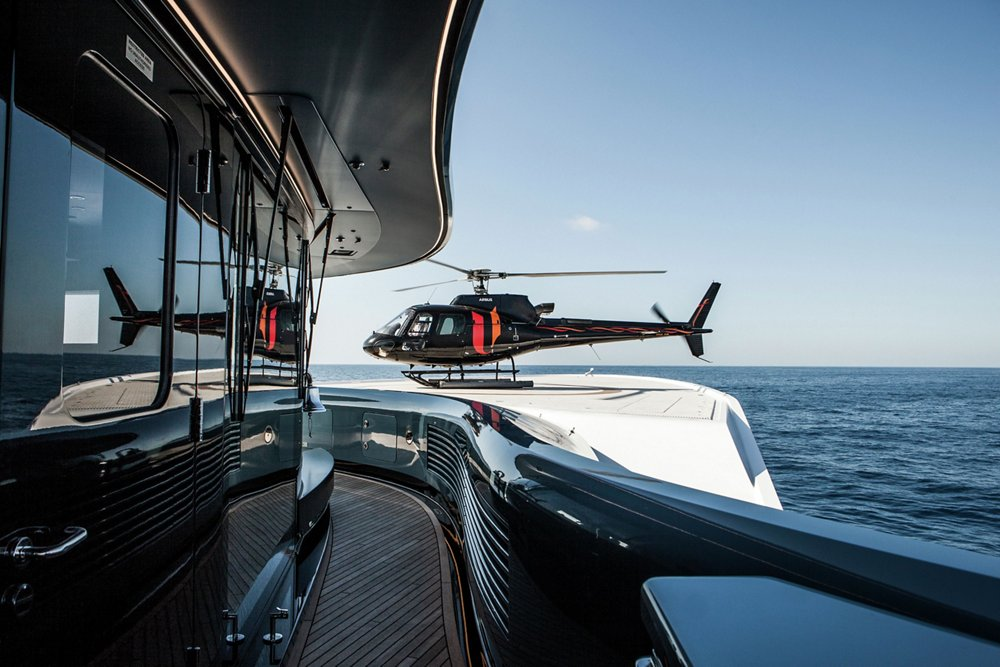 Passengers exit an Airbus H125 helicopter configured for private and business aviation