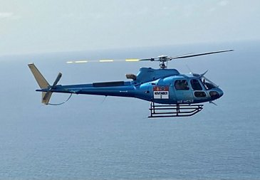 H125 in flight at Dakar Rally