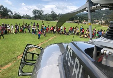 Savannah Helicopters H125 with local population