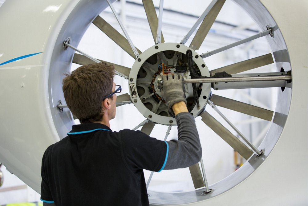 Maintenance is performed on a helicopter's shrouded Fenestron tail rotor.