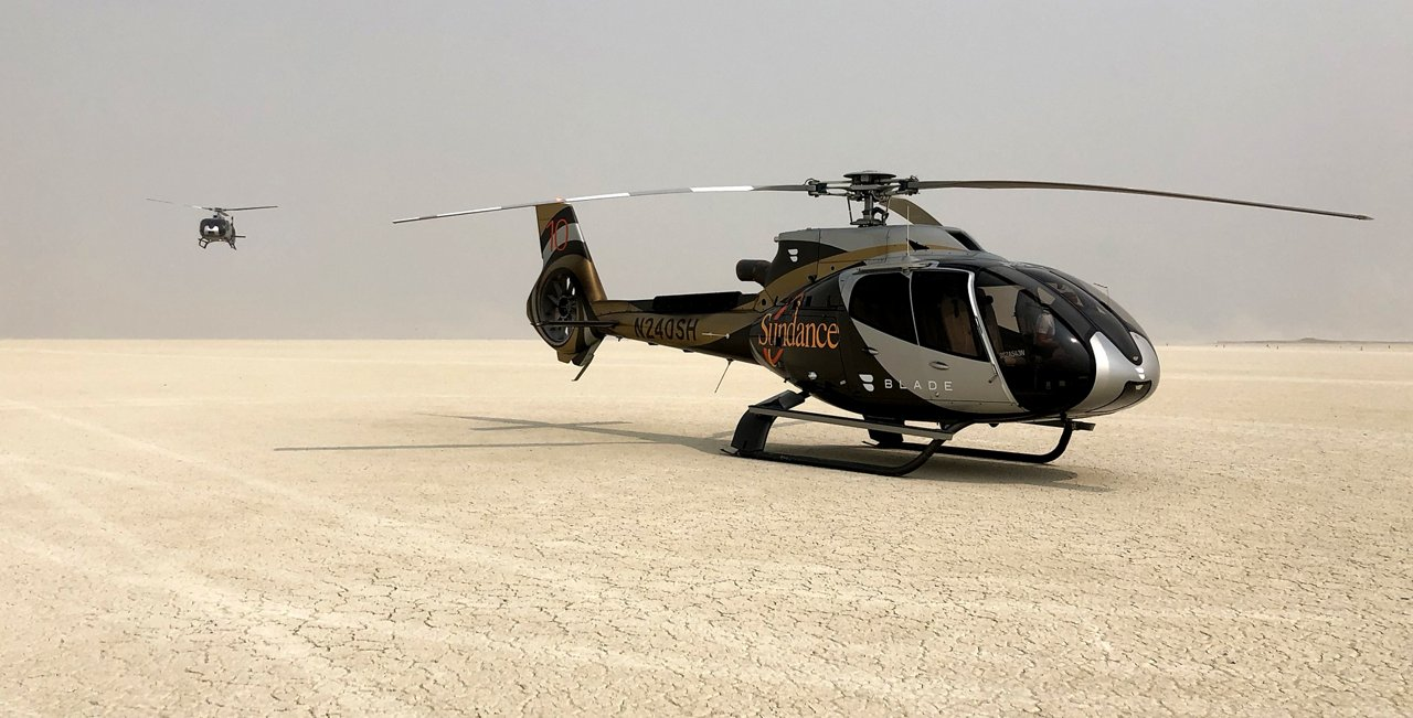 """Fly Blade, Inc. (""""Blade"""") has partnered with Sundance Helicopters based in Las Vegas, NV, to offer helicopter taxi flights on an H130 to Black Rock City for the 2018 Burning Man event, turning what is for many an 8-hour drive into a 45-minute journey. With its low sound levels, large cabin and panoramic windows, the H130 is a leader in the tourism and passenger transport sector."""