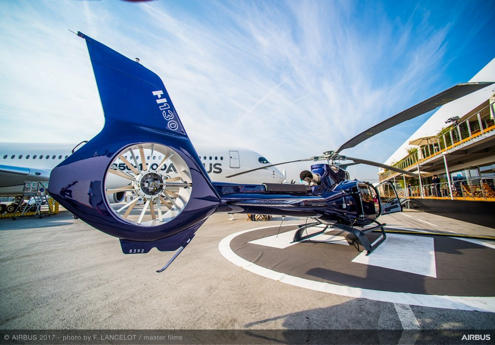 A detailed view of an Airbus H130 helicopter's Fenestron? tail rotor