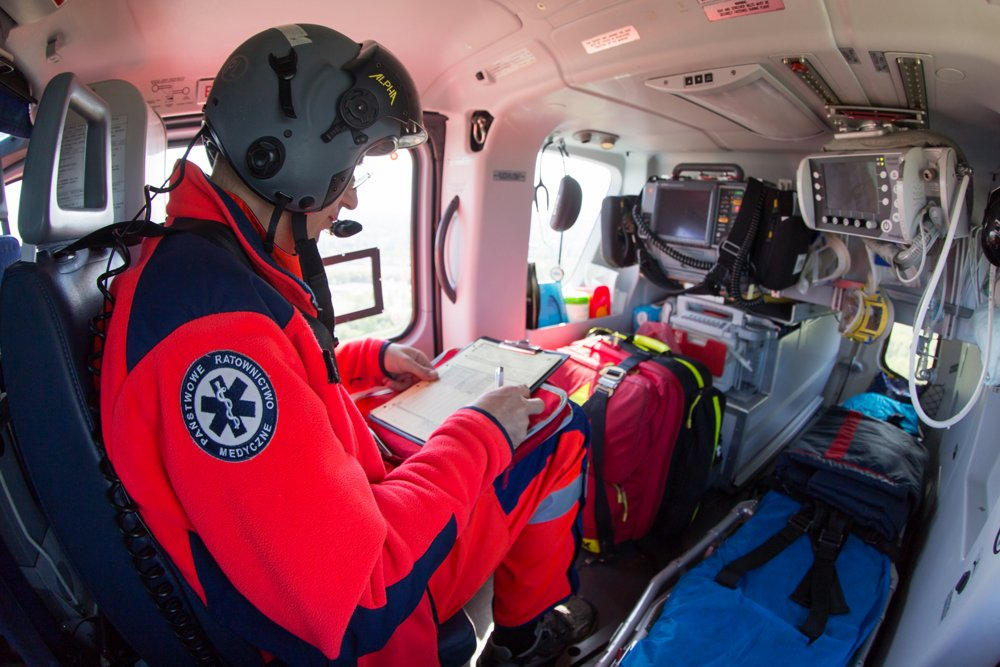 A view inside the cabin of a HEMS-configured H135 operated by Lotnicze Pogotowie Ratunkowe of Poland, with a seated medic.